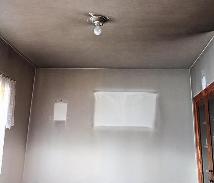 smoke damaged wall and ceiling