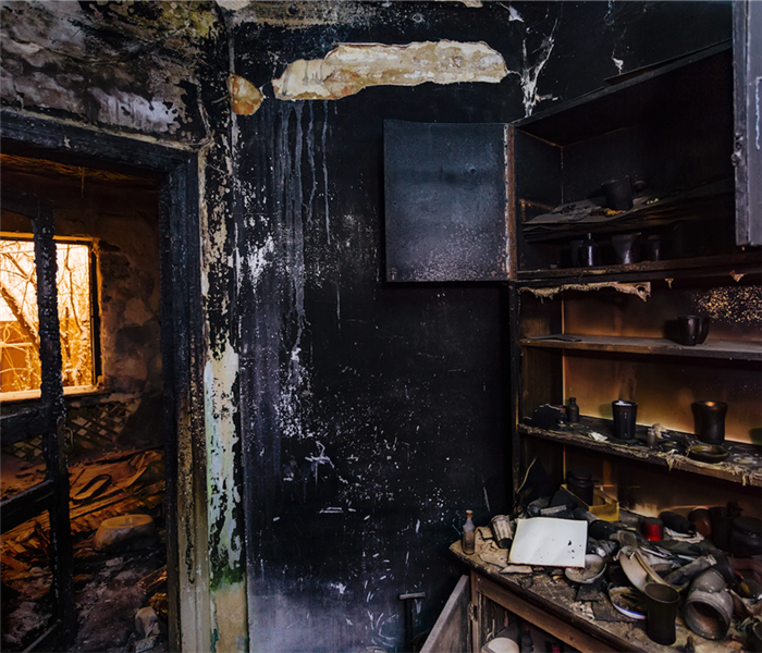 charred and fire damaged room in a home