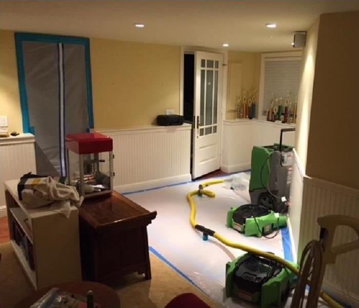 SERVPRO restoration equipment being used in water damaged home